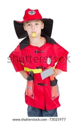 little boy firefighter blowing his whistle - stock photo