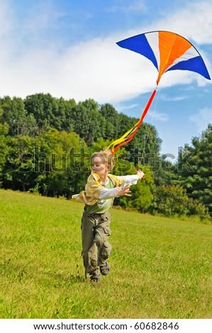 Little boy flying a kite - stock photo