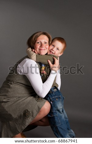 little boy gently embrace pregnant mother - stock photo