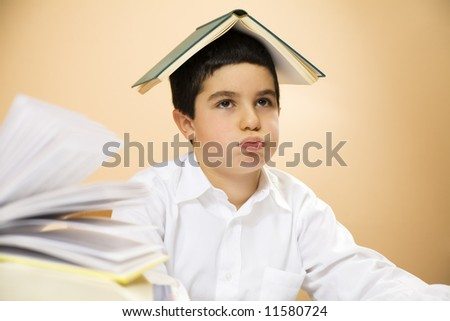 little boy getting bored of doing homeworks - stock photo