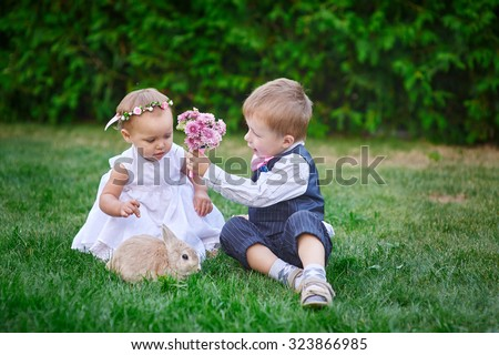 Little boy gives a girl a bouquet of flowers.