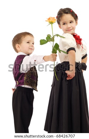 Little boy gives a girl a yellow rose, isolated on white - stock photo