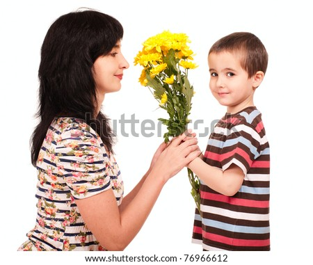 Little boy gives yellow flowers to his mom isolated on white - stock photo