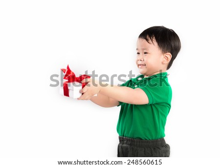 Little boy giving gift to his mom, his teacher, his sister on women's day. Asian kid giving a present. isolated over white background - stock photo