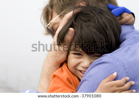 Little boy giving his father a big hug