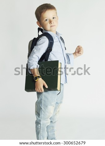 little boy going to school.child with backpack and book.education and school concept - stock photo