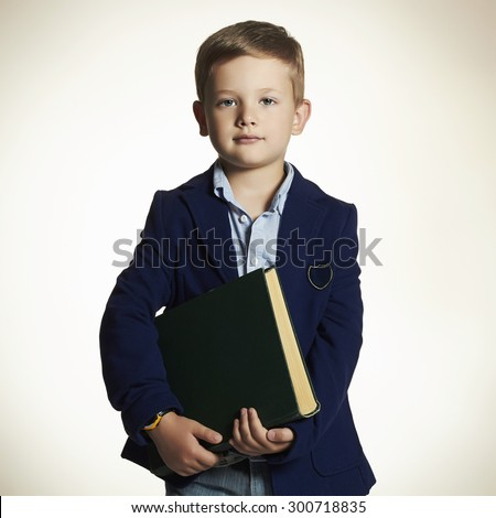 little boy going to school.child with book.education and school concept - stock photo
