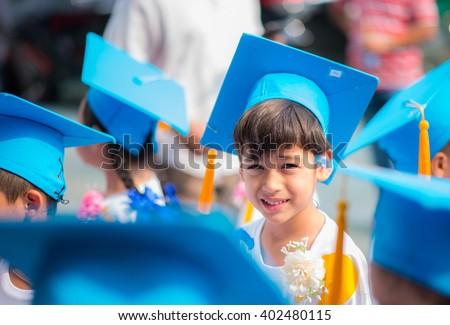 Little boy graduated at kindergarten school - stock photo