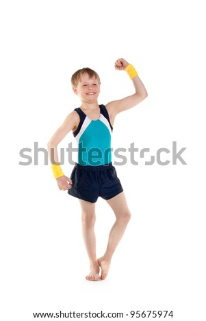 little boy gymnast showing his muscles - stock photo
