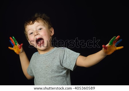 little boy hands painted in bright colors - stock photo