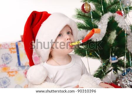 little boy happily celebrating Christmas - stock photo
