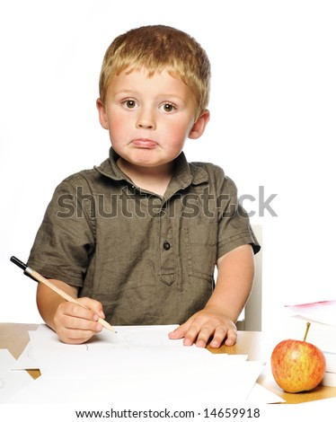 Little boy hard at work - stock photo