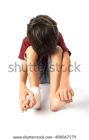 Little boy has an accident with his leg need bandage for first aid - stock photo