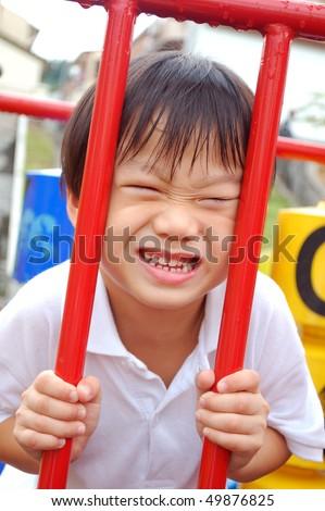 little boy having fun at playground - stock photo