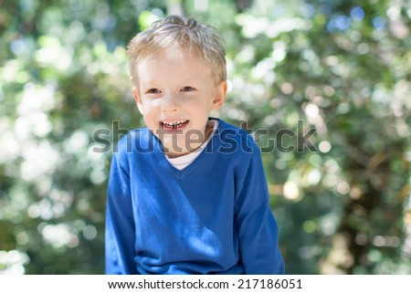 little boy having fun in the forest - stock photo