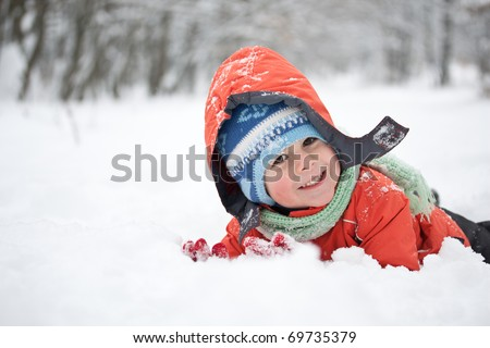 Little boy having fun in the snow
