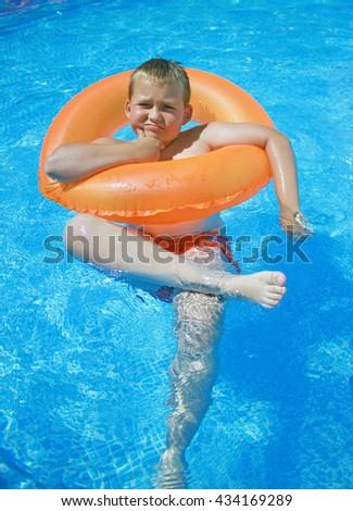 little boy having fun in the swimming pool - stock photo