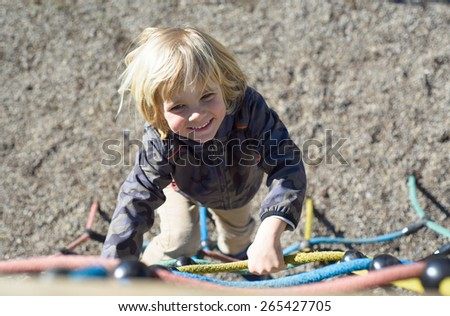 Little boy having fun on the playground - stock photo