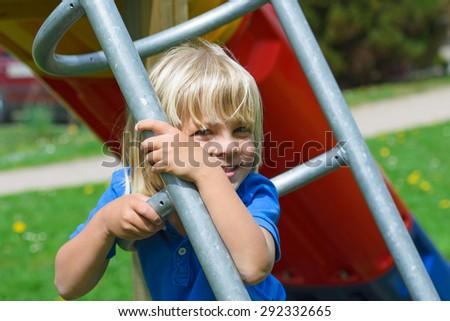 Little boy having fun on the playground - stock photo
