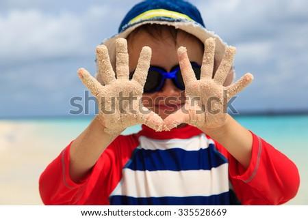 little boy having fun on tropical beach vacation - stock photo
