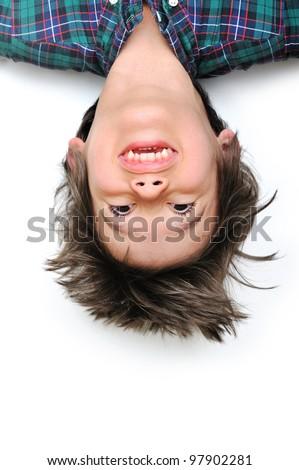 Little boy having fun upside down - stock photo
