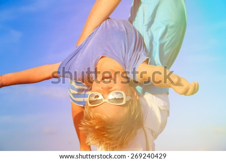 little boy having fun with father on summer sky - stock photo