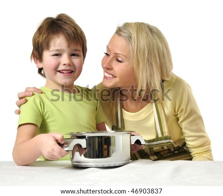 Little boy helps his mother to cook - stock photo
