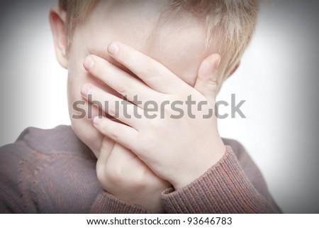 little boy hide - stock photo