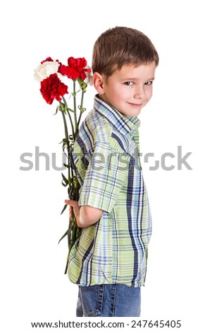 Little boy hiding the bouquet of carnations, isolated on white - stock photo