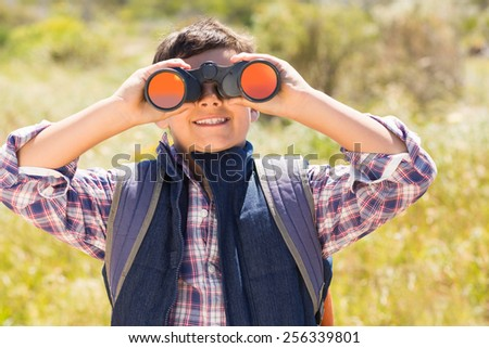 Little boy hiking in the mountains on a sunny day - stock photo