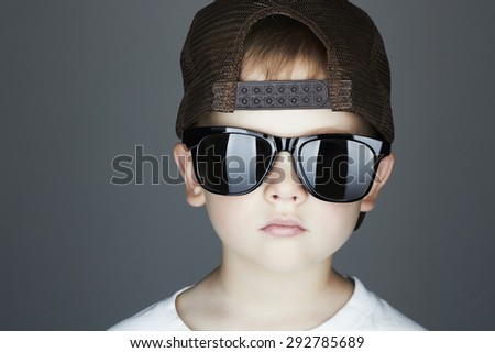 little boy.Hip-Hop Style. fashion children.handsome in sunglasses.Young Rapper. Serious Child in Cap - stock photo