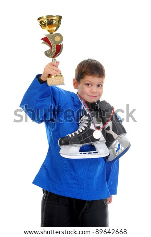 Little Boy Hockey Player. Isolated on white background - stock photo