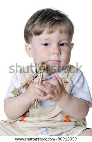 little boy hold in hand the big keys (isolated on a white background)