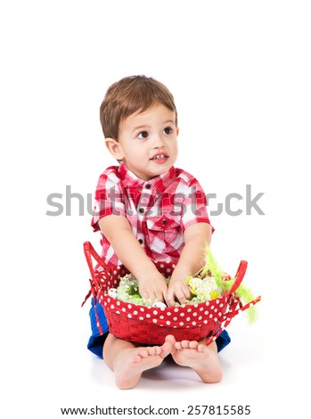 little boy holding a basket with Easter eggs on white background