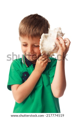Little boy holding  a big shell isolated on white background - stock photo