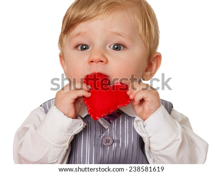 Little Boy holding a Heart Shape. Symbol of life.