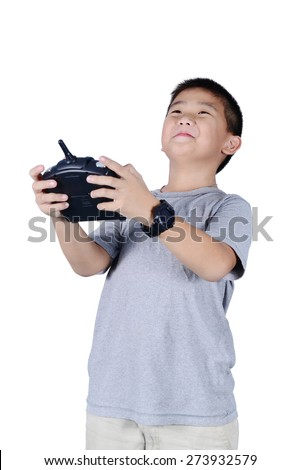 Little boy holding a radio remote control (controlling handset) for helicopter , drone or plane Isolated on white background. - stock photo