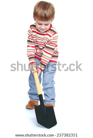 Little boy holding a shovel.Isolated on white background portrait. - stock photo