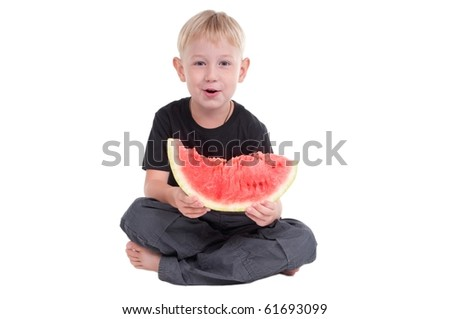 Little boy holding a slice of watermelon