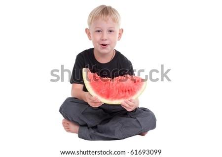 Little boy holding a slice of watermelon - stock photo