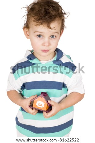 little boy holding a toy house isolated on white - stock photo