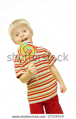 Little boy holding a very large lollipop - stock photo