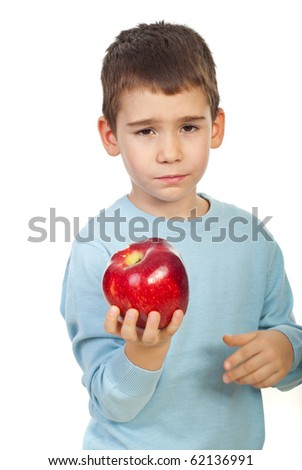 Little boy holding and apple and looks tired of  to much eating apples or not like this fruit  isolated on white background - stock photo