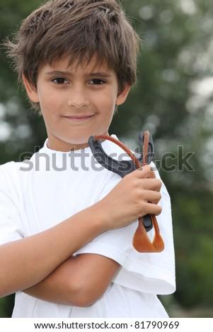 Little boy holding catapult - stock photo