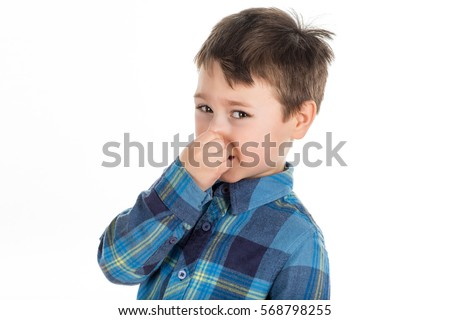 Little boy holding his nose