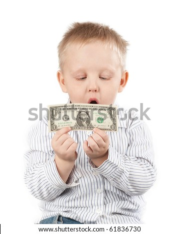 Little boy holding money with a happy surprised look - stock photo