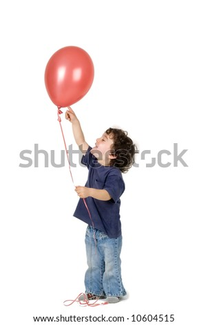 little boy holding red balloon