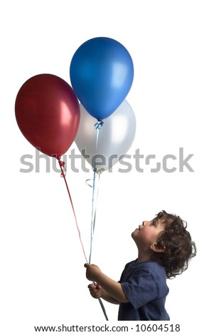 little boy holding red blue and white balloons - stock photo