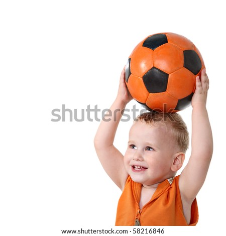 Little boy holding soccer ball - stock photo