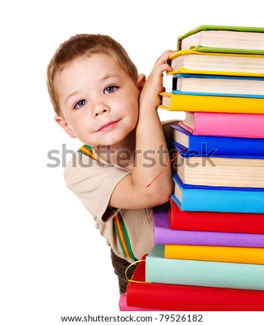 Little boy holding stack of books. - stock photo